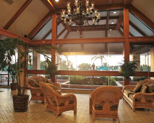 Lounge area of the Surf Club of Marco resort with an outside view.