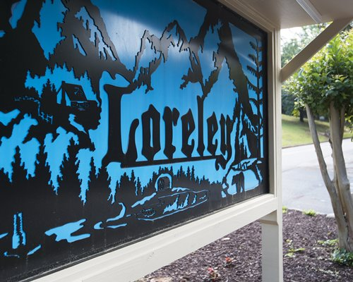 Wooded signage board of Loreley Resort.