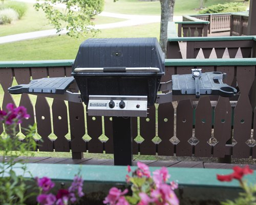 Barbecue stove on a wooden patio.