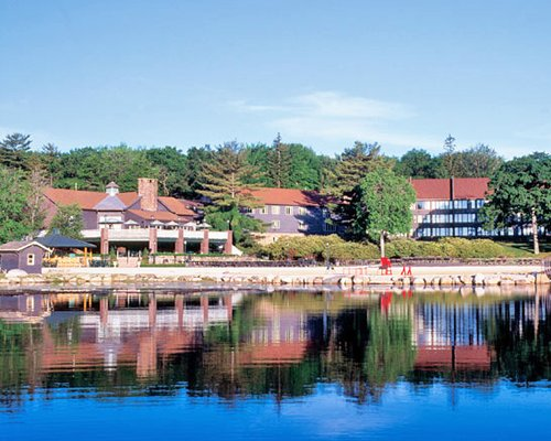 A lake view of The Resort at Split Rock surrounded by wooded area.