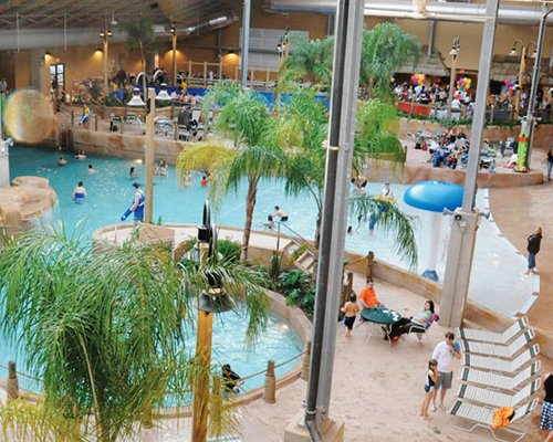 An indoor amusement park with swimming pool.