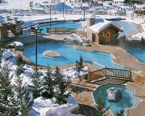 An aerial view of Panorama Vacation Retreat resort covered in snow.