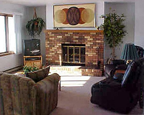Furnished living room with fireplace and an outside view.