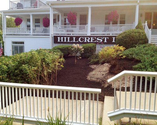 A view of the Hillcrest Condominiums resort main building from a wooden deck.
