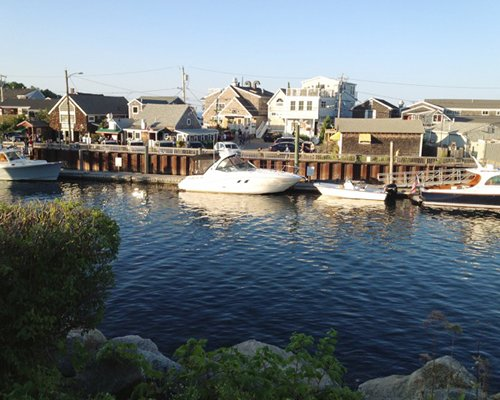 A view of the ocean with motor boats alongside the resort.