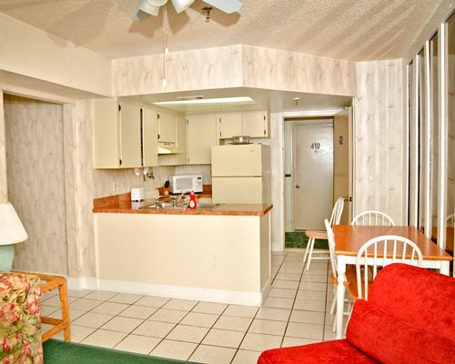 A well equipped open plan kitchen with dining area.
