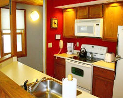 A well furnished kitchen with stove and refrigerator.