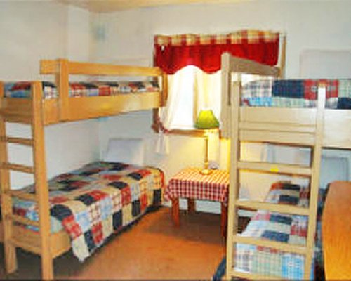 Furnished bedroom with two bunk beds.