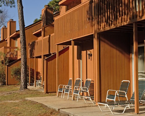 An outdoor view of multiple units with patio furniture.