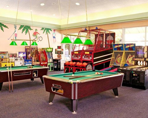Recreation room with pool tables and arcade games.