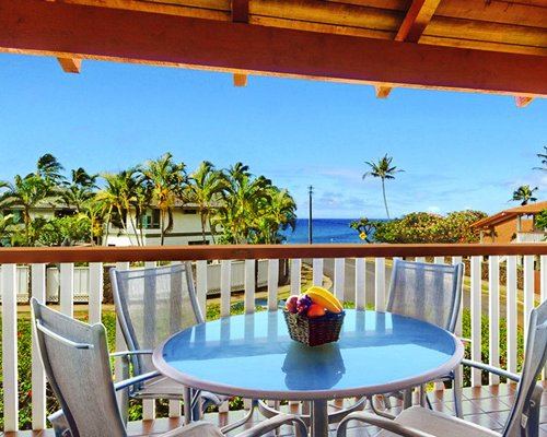 Balcony with patio table and ocean view.