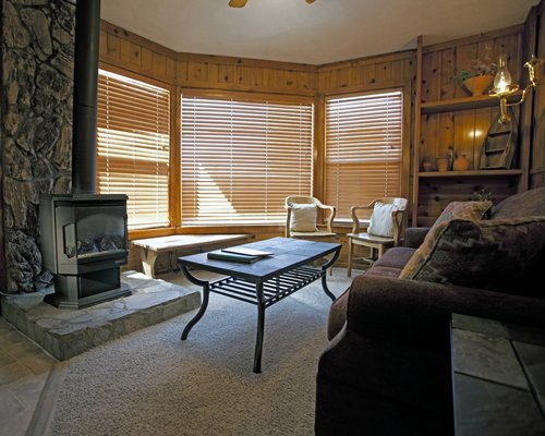Furnished living room with fireplace.