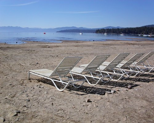 A view of chase lounge chairs facing the lake.