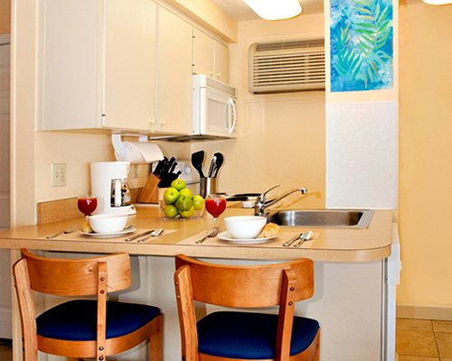 Furnished kitchen with breakfast bar.
