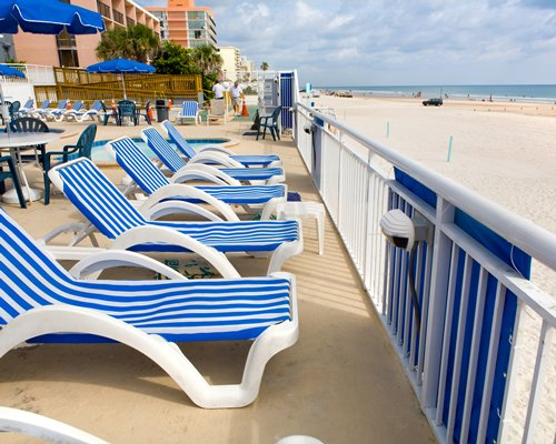 A view of chase lounge chairs facing the beach.