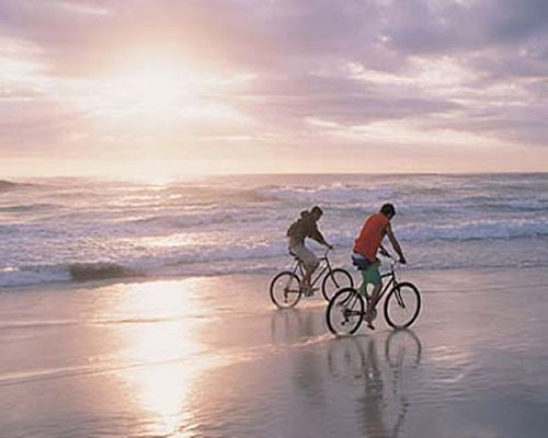 Couple cycling at the beach.