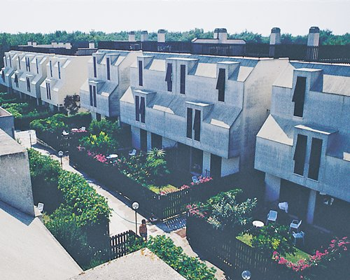 Scenic exterior view of multi story unit.