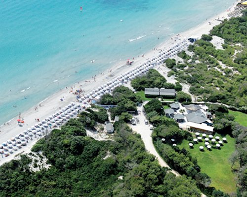 An aerial view of Serra Degli Alimini 1 resort alongside ocean.