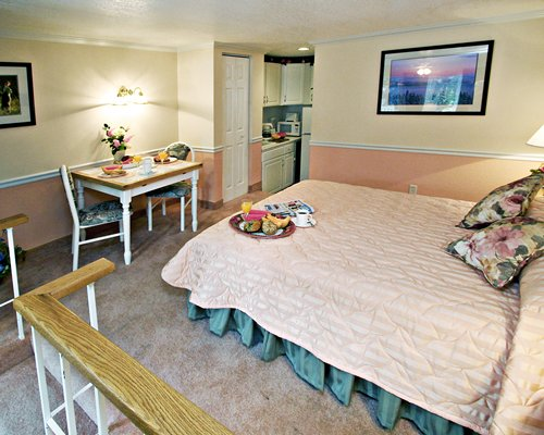 An open plan bedroom with dining alongside kitchen.