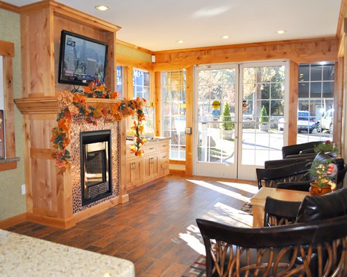 A well furnished living room with fireplace television and an outdoor view.