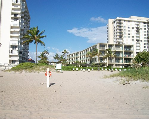 A beach view of multi story suites.