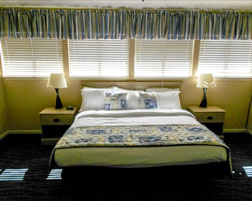 A well furnished bedroom with a king bed.