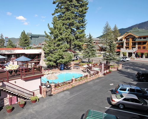 An aerial view of Stardust Lodge with an outdoor swimming pool and car parking area.