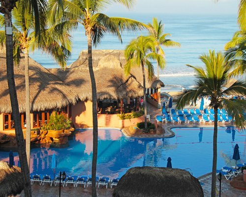 Scenic view of Vacation Internationale Torres Mazatlan with outdoor pool and ocean.