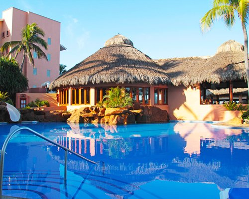 Large outdoor swimming pool with poolside bar.