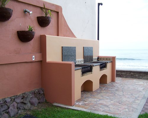 An outdoor barbecue stove alongside the beach.