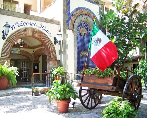 Entrance to Vacation Internationale Vallarta Torre with a Mexican Flag.