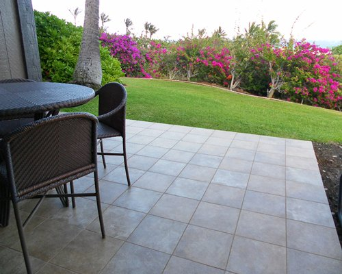 Scenic outdoor patio with patio furniture.