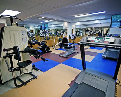 An indoor fitness area with exercise equipment.