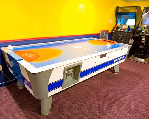 An indoor recreation area with table hockey.