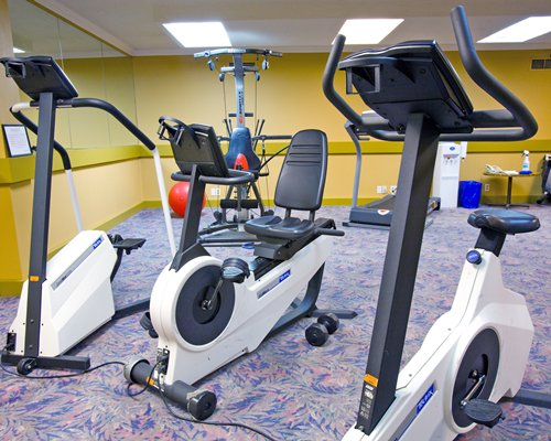 Indoor fitness area with exercise equipment.