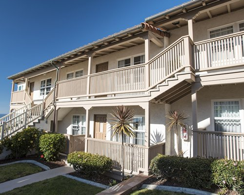 Scenic exterior view of multiple unit balconies at Casa De La Playa.