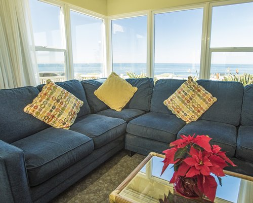 A well furnished living room with outdoor ocean view.