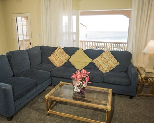 A well furnished living room with balcony and ocean view.