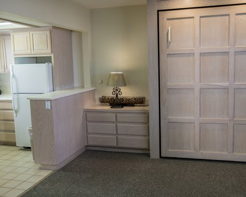A well furnished living room with kitchen area.