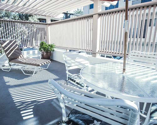 Rest place with chaise lounge chairs and patio furniture.