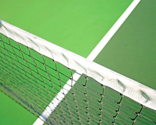 Close up of an outdoor tennis court.