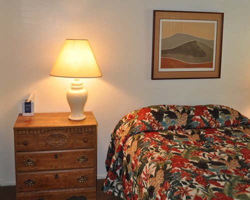 A well furnished bedroom with a full bed.