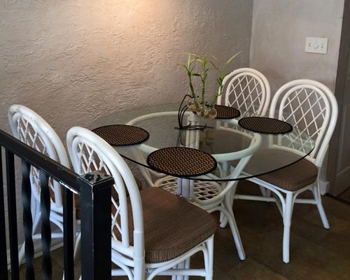 An open plan living room dining room and kitchen with a breakfast bar.