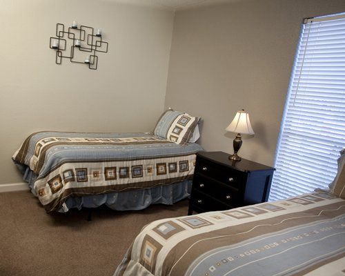 A furnished bedroom with two twin beds.
