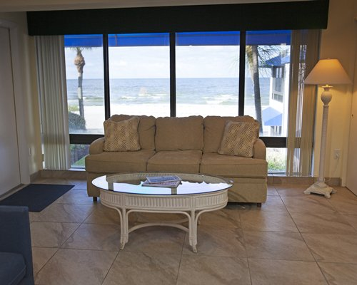 A well furnished living room with a double pull out sofa and an outdoor view.