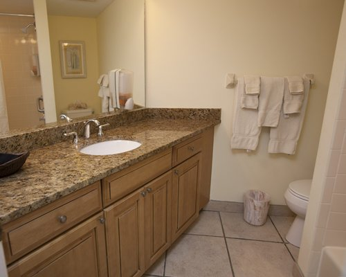 A bathroom with shower and vanity.