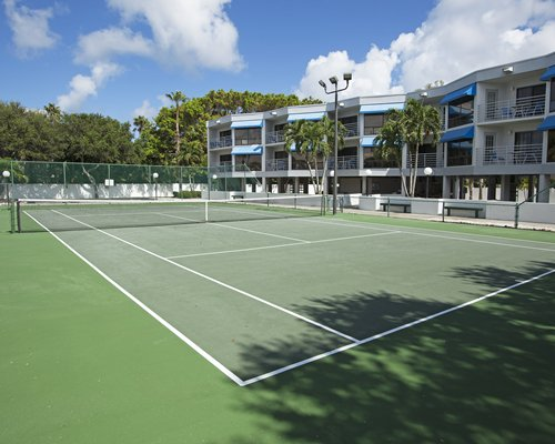 View of multiple unit balconies with outdoor tennis court.