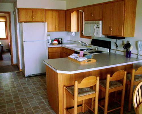 A well furnished kitchen with a breakfast area.