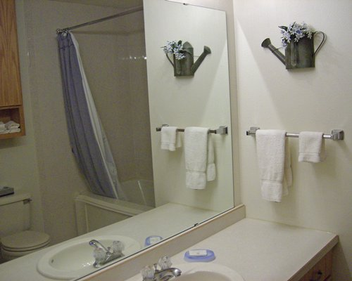 A bathroom with shower and bathtub with vanity.