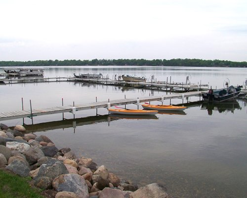 View of multiple boats at the lake.